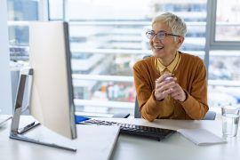 Woman working at a computer and smiling